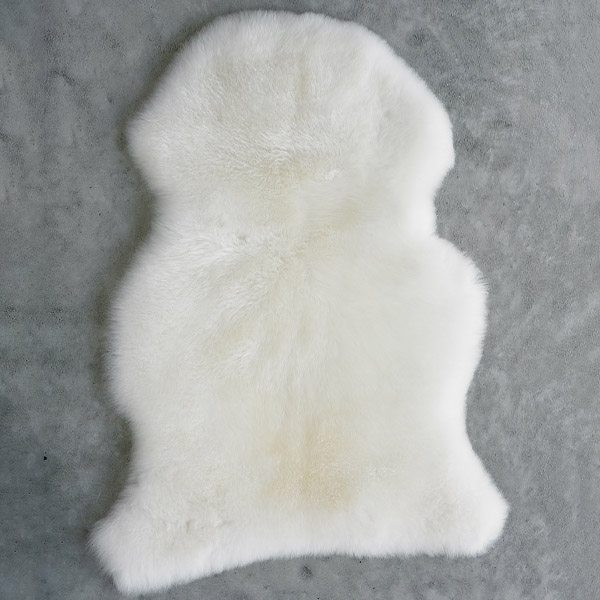 cream infant care rug