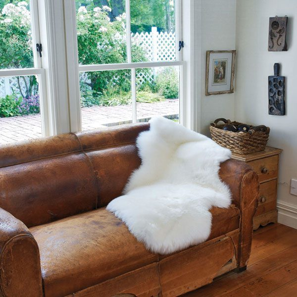 single white sheepskin on couch